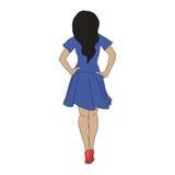 一双蓝色礼服和红色鞋子的女孩 免版税库存照片