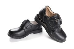 一只新的皮鞋和一损坏的老一个 图库摄影