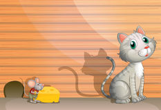 一只猫和一只鼠用乳酪 免版税图库摄影
