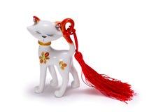 一只白色猫的美丽的小雕象 库存图片