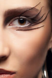 一只眼睛的近景与哥特式的组成 免版税库存照片