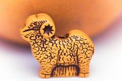 一只羊羔的小图用在的桔子 免版税库存照片
