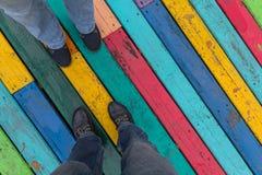 一只脚的顶视图在一双鞋子的有地板的 库存图片