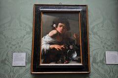 一只蜥蜴咬住的男孩Caravaggio在全国画象画廊,伦敦 库存图片
