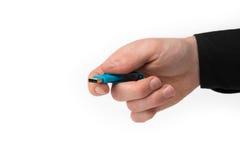 一只被隔绝的手用USB棍子 免版税库存照片