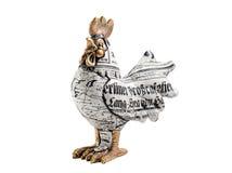 一只雄鸡的小雕象在白色背景的 免版税图库摄影