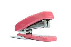 一台桃红色订书机在白色背景中 免版税库存照片