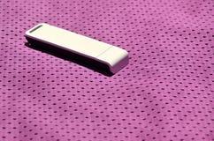 一台现代便携式USB Wi-Fi适配器在紫色运动服被安置由聚酯尼龙fibe制成 免版税库存照片