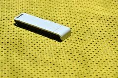 一台现代便携式USB Wi-Fi适配器在黄色运动服被安置由聚酯尼龙fibe制成 库存图片
