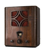 一台年迈的木模式收音机的被删去的静物画 库存照片