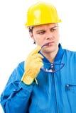 一名体贴的建筑工人的画象有盔甲的 库存图片