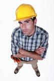 一名半信半疑的建筑工人。 免版税图库摄影