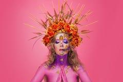 一名妇女的画象有面孔艺术的仿照死者和新生的天样式 免版税库存照片