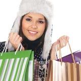 一名妇女的纵向在冬天帽子藏品请求 免版税图库摄影