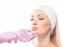 一名妇女的纵向botox程序的 免版税库存照片