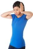 一名妇女的画象有巨大的头疼的 免版税库存图片