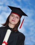一名妇女的画象毕业褂子的 免版税库存照片