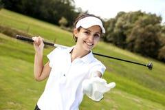 一名妇女的画象高尔夫球领域的 免版税库存图片