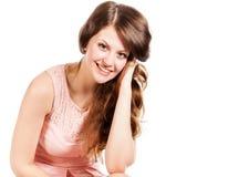 一名微笑的妇女在工作室 免版税库存照片