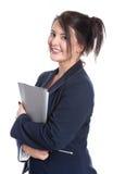 一名微笑的年轻女实业家的画象衣服的去a 免版税库存图片