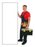 一名愉快的白种人建筑工人的全长画象有空白的广告牌的 在白色背景隔绝的水管工 库存照片
