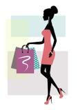 一名时兴的购物妇女的剪影 免版税库存图片