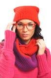 一名深色的妇女的纵向温暖的红色衣裳的 免版税库存图片