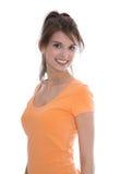 一名相当年轻微笑的妇女的画象被隔绝在白色。 免版税库存图片
