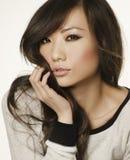 一名美丽的亚裔妇女的面孔的画象 图库摄影