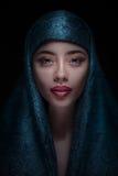 一名美丽的妇女的画象paranja的 库存照片
