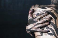 一名肮脏的妇女 免版税图库摄影