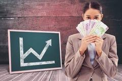 一名贪婪的女实业家的画象的综合图象拿着钞票的 库存图片