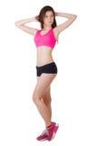 一名年轻美丽的运动的妇女佩带的体育短裤和上面的演播室画象 免版税库存照片