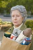 一名年长妇女的雕塑告诉 免版税库存图片