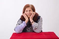 一名年长妇女的画象有哀伤的面孔表示的 库存照片