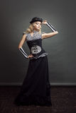 一名steampunk妇女的画象帽子常礼帽帽子的有风镜的 一个维多利亚女王时代的样式的美丽的夫人 库存图片