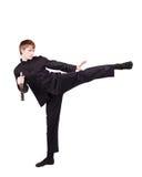 一和服实践的kung fu的人与nunchaku 免版税图库摄影