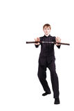 一和服实践的kung fu的人与nunchaku 库存照片