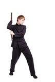 一和服实践的kung fu的人与nunchaku 免版税库存照片
