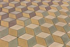 一块单调色的砖石头的看法在地面上的str的 库存照片