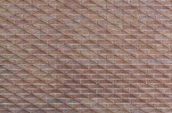 从一块现代砖的墙壁与作为背景的一个样式 库存照片
