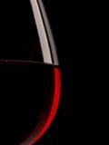 一块红葡萄酒玻璃的剪影 免版税图库摄影