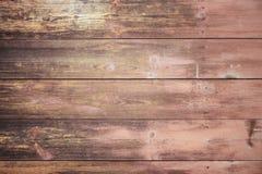 一块老木匾的纹理在樱花,背景的一textur洗染了 免版税库存照片