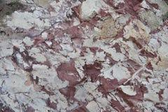 一块非常老石头的五颜六色的自然表面,整个自然石背景 免版税库存图片