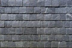 一块黑易碎的石头的方形的板材 库存照片