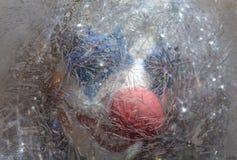 一块冻玻璃的小丑 库存照片