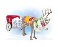 一头鹿的图片与雪撬的 图库摄影