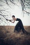 一套哥特式衣服的女孩 图库摄影