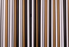 一套多彩多姿的塑料管秸杆背景的 图库摄影