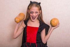 一套服装的快乐的小女孩为万圣夜 图库摄影